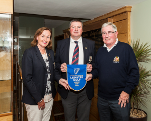 Lady Captain Mary Lou Grennan, Captain Brendan Keane and President Tom Clarke with the Leinster Junior Cup Pendant.